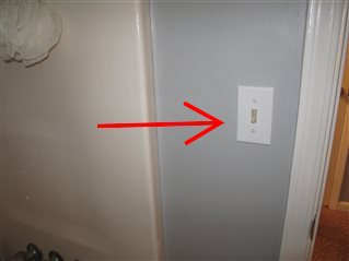 Wall-mounted electric switches are within reach of shower stalls.