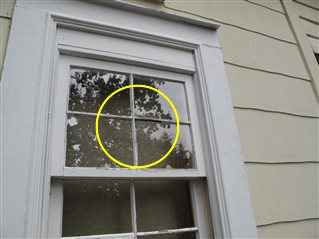 Window glazing putty at one or more windows is missing.
